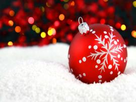 Red Christmas Ornament With Snow and Lights Photo Backgrounds