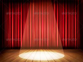 Theater Stage With A Red Curtain and A Spotlight Photo Backgrounds